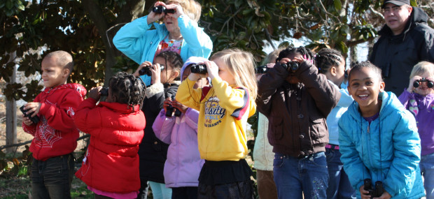 Photo of children looking through binoculurs during Nature Time