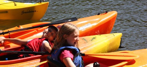 Two girls enjoying kayaking