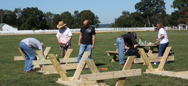 Volunteers build picnic tables