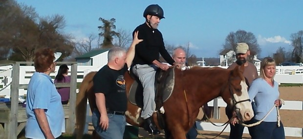 Volunteers assist a rider