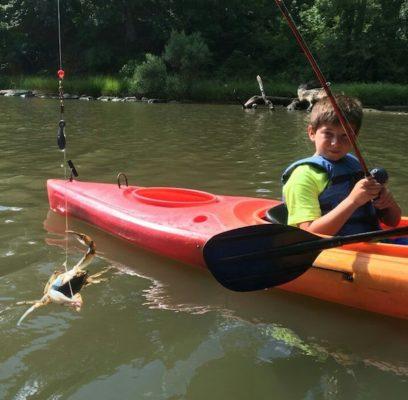 Kayak fishing camper catch crab
